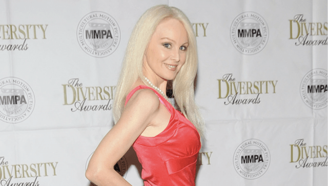 Donna Spangler posing on a red carpet.