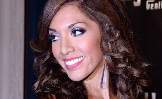 Farrah smiling while at an event.