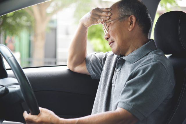 Senior man having difficulties driving