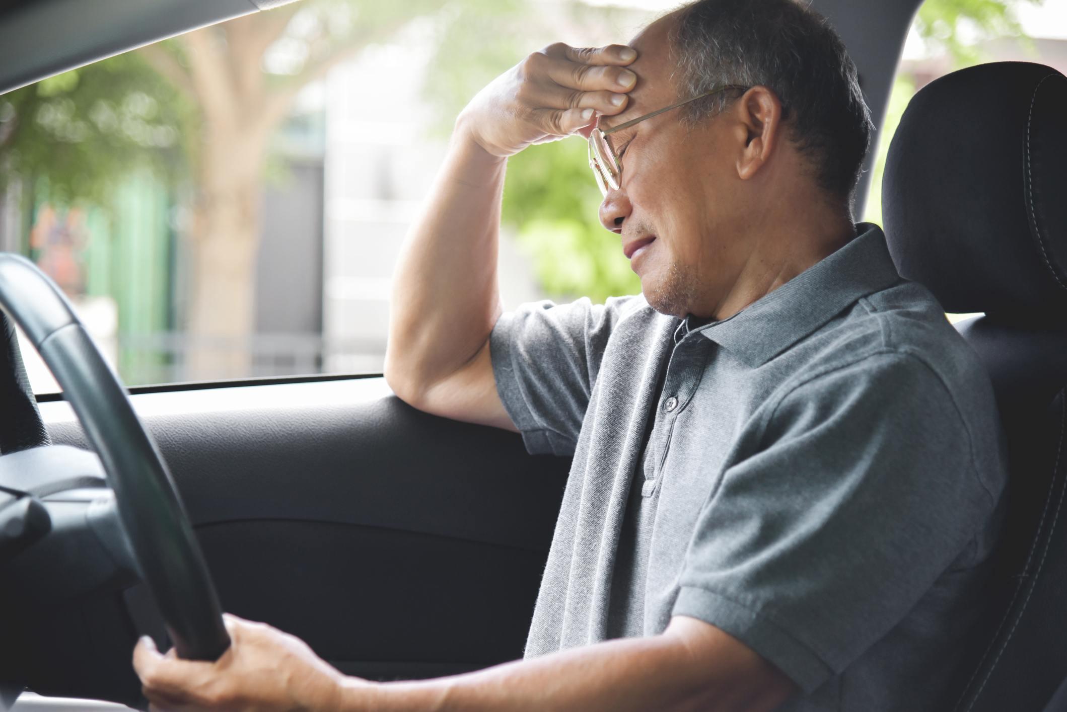 Senior man having difficulties driving