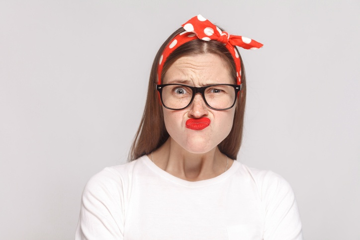 Hipster woman wearing glasses and a headband
