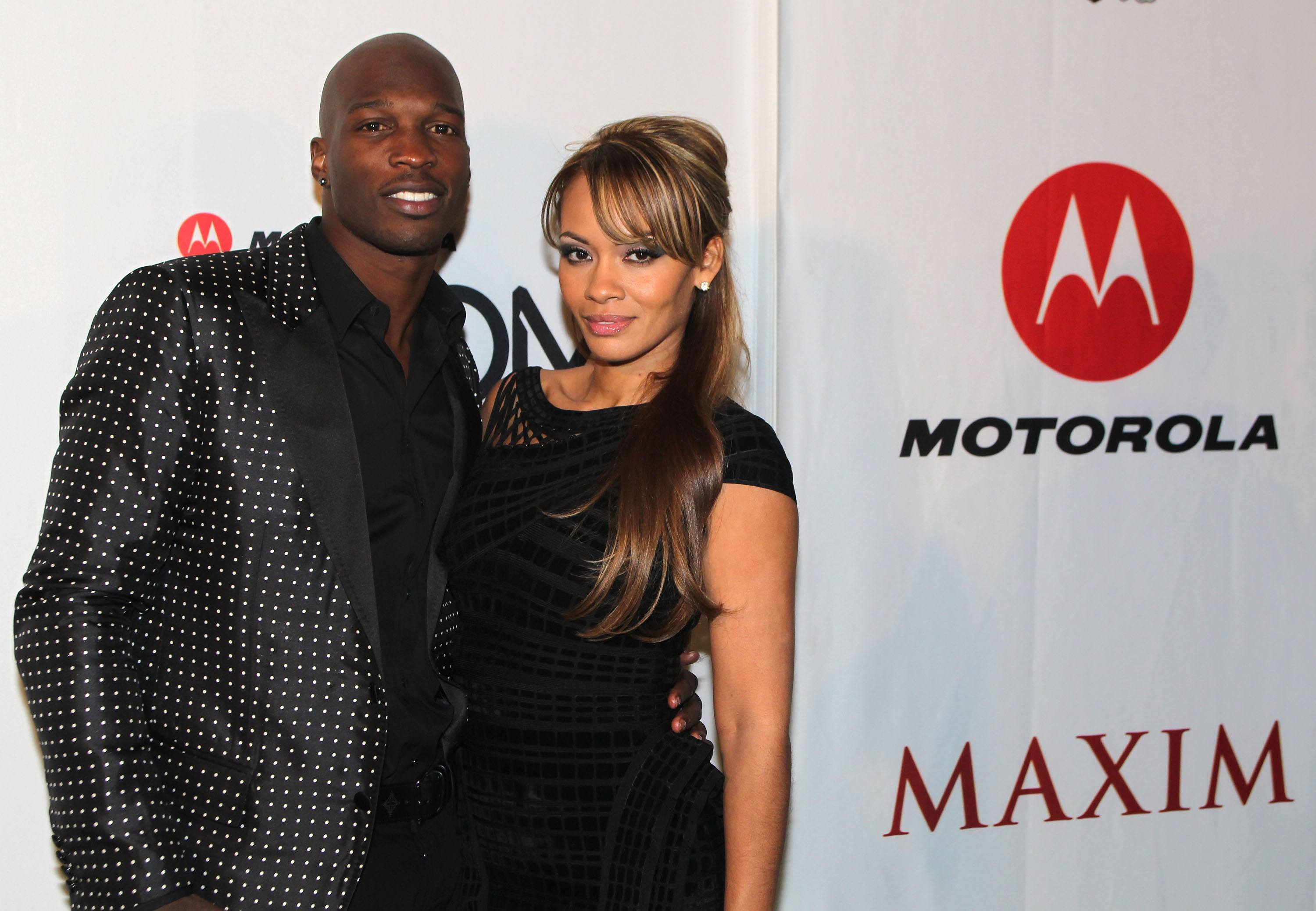 NFL player Chad Ochocinco and Evelyn Lozada pose with Motorola Xoom at the Maxim Party Powered by Motorola Xoom at Centennial Hall at Fair Park on February 5, 2011 in Dallas, Texas