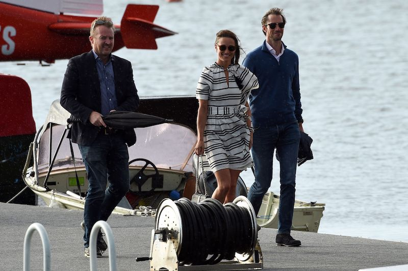 Pippa Middleton (C) and her husband James Matthews (R) arrive at Rose Bay Wharf by sea plane in Sydney on May 31, 2017.<br />