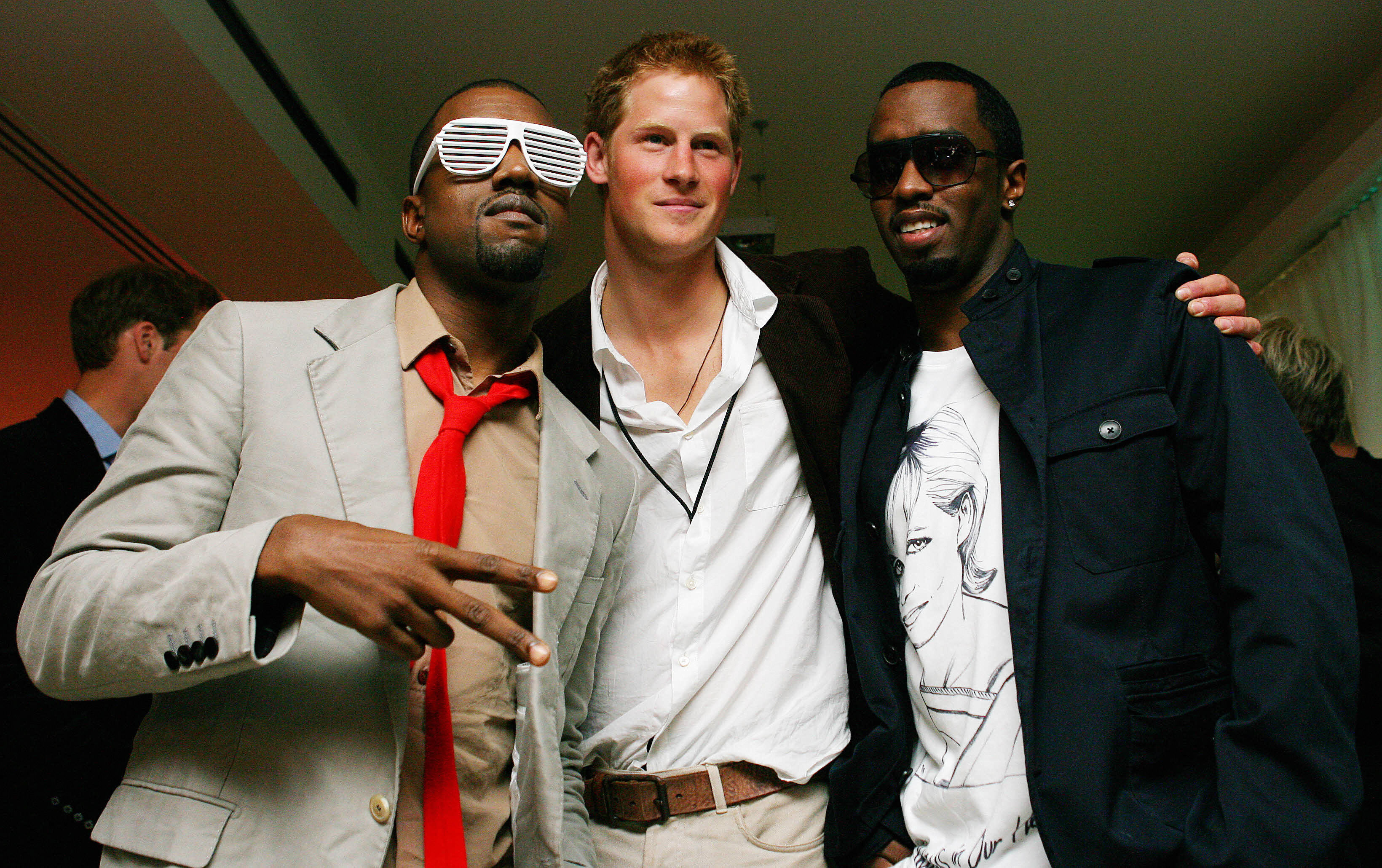 Kanye West poses with Prince Harry and Diddy at Wembley Arena in north London, 01 July 2007