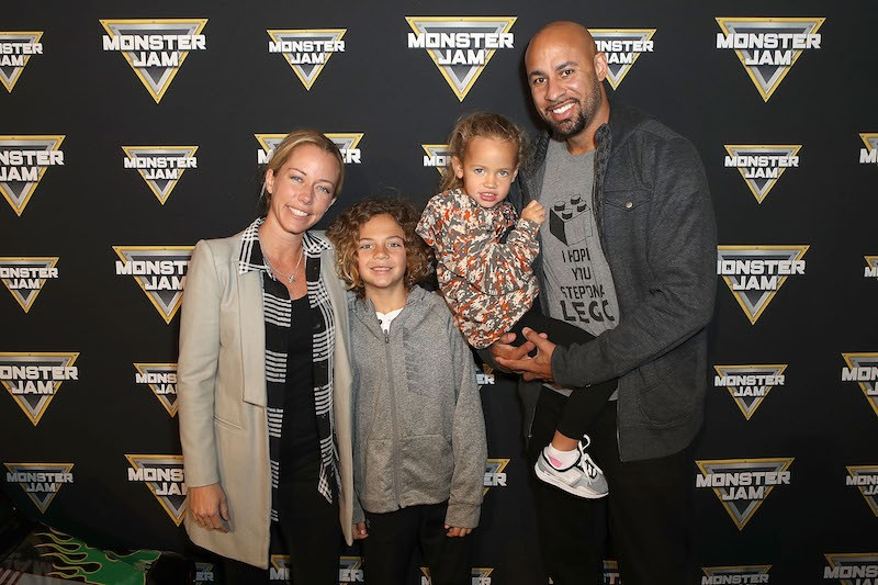ANAHEIM, CA - FEBRUARY 24: (L-R) TV Personality Kendra Wilkinson Baskett, son Hank, daughter Alijah, and Hank Baskett arrive at Monster Jam Celebrity Event at Angel Stadium on February 24, 2018 in Anaheim, California. (Photo by Ari Perilstein/Getty Images for Feld Entertainment)