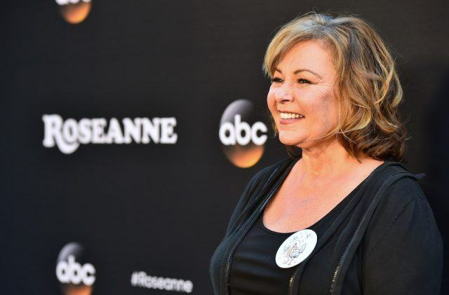 Roseanne Barr smiling on a red carpet.