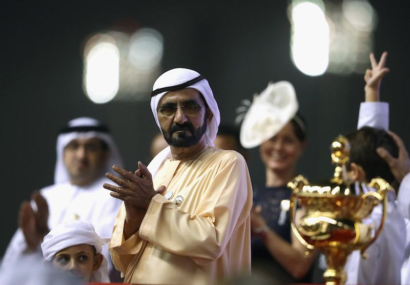 DUBAI, UNITED ARAB EMIRATES - MARCH 31: Sheikh Mohammed bin Rashid Al Maktoum, Vice President and Prime Minister of the United Arab Emirates and ruler of the Emirate of Dubai looks at the winner trophy during the Dubai World Cup Race Day at Meydan Racecourse on March 31, 2018 in Dubai, United Arab Emirates. (Photo by Francois Nel/Getty Images)