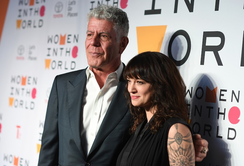 Chef Anthony Bourdain and actor Asia Argento attend the 2018 Women In The World Summit at Lincoln Center on April 12, 2018 in New York City. / AFP PHOTO / ANGELA WEISS (Photo credit should read ANGELA WEISS/AFP/Getty Images)