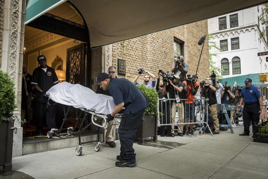 City workers carry the body of fashion designer Kate Spade out of her apartment building after she was found dead of an apparent suicide on June 5, 2018 in New York City