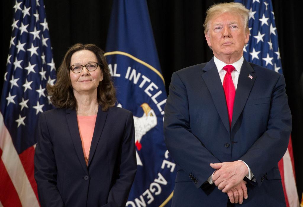 US President Donald Trump stands alongside Gina Haspel