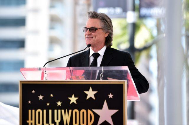 Actor Kurt Russell speaks onstage as he and Goldie Hawn are honored with a double star ceremony