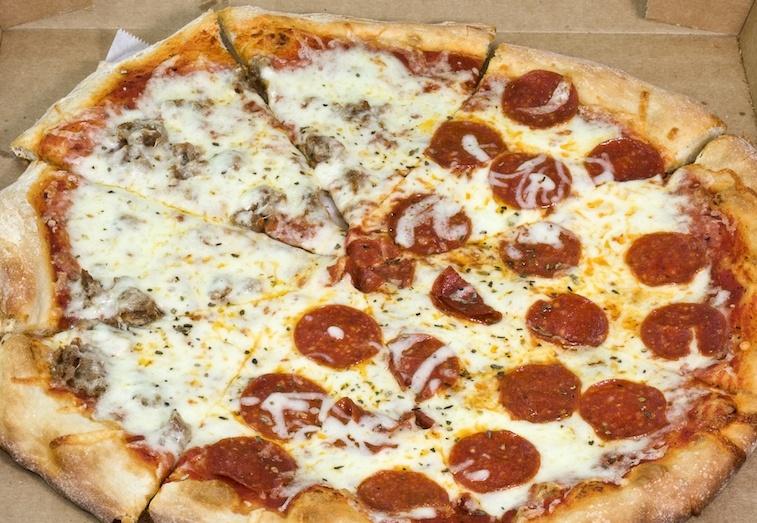 Half pepperoni half sausage pizza