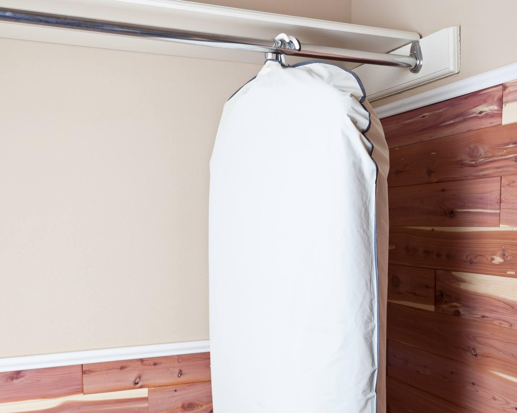 garment bag hanging in cedar closet