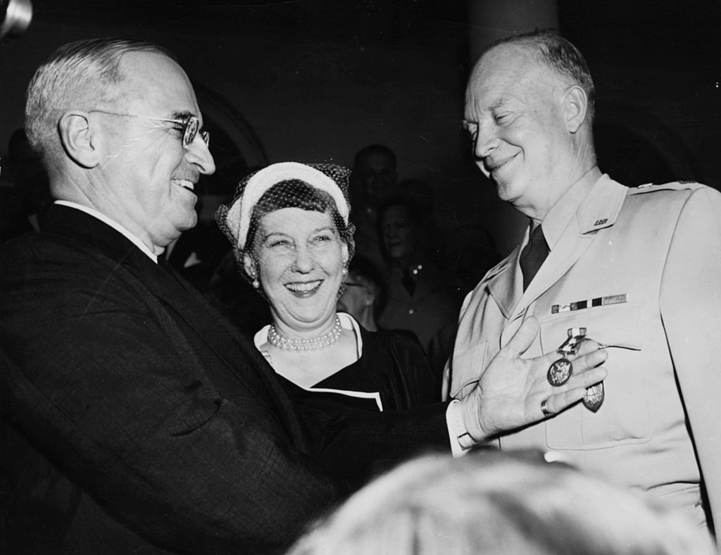 Mamie Eisenhower looks on, at the White House