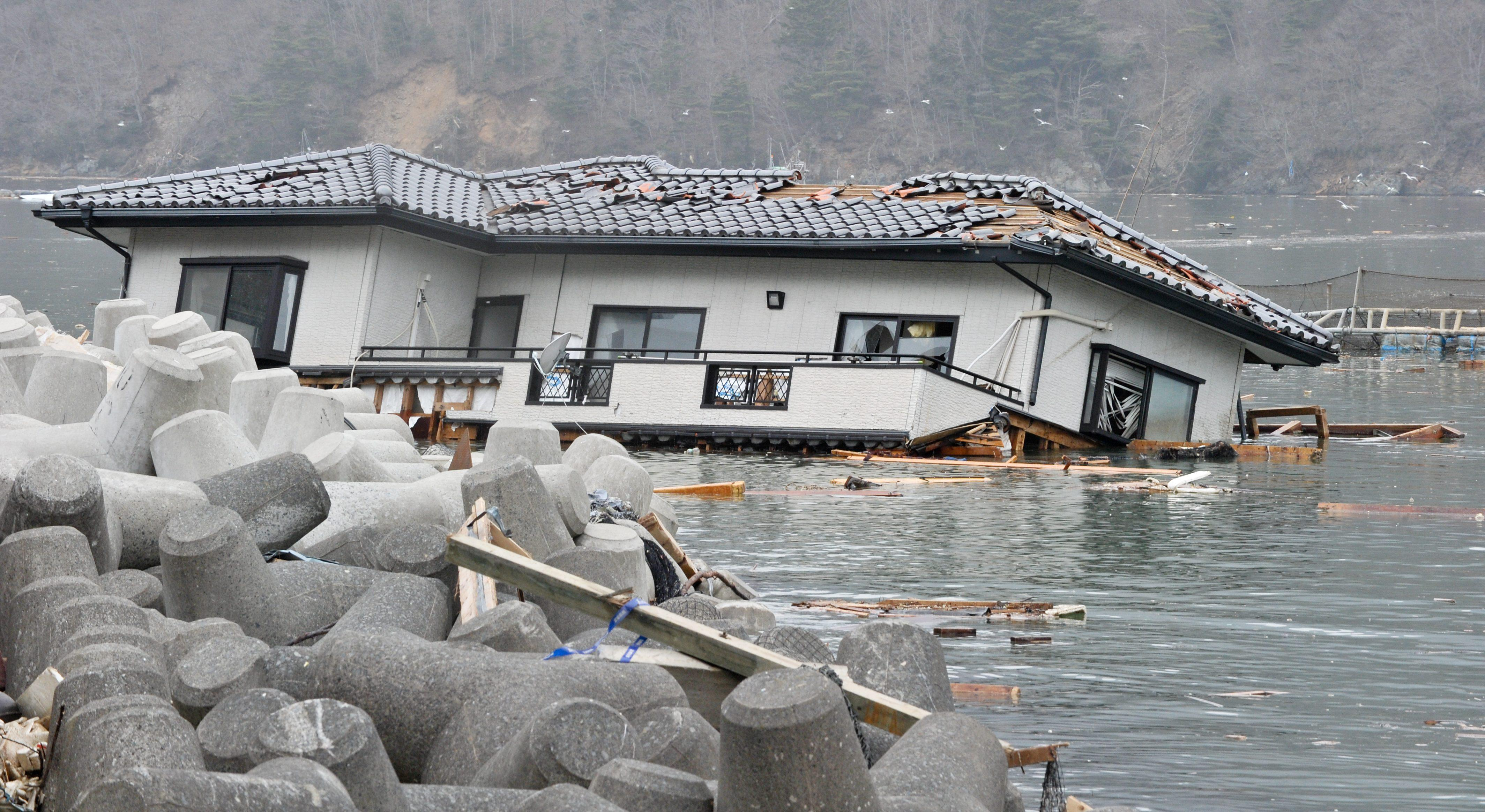 House in the sea after the tsunami in Japan