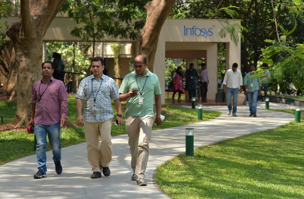 Employees of Infosys Technologies Limited walk in the campus