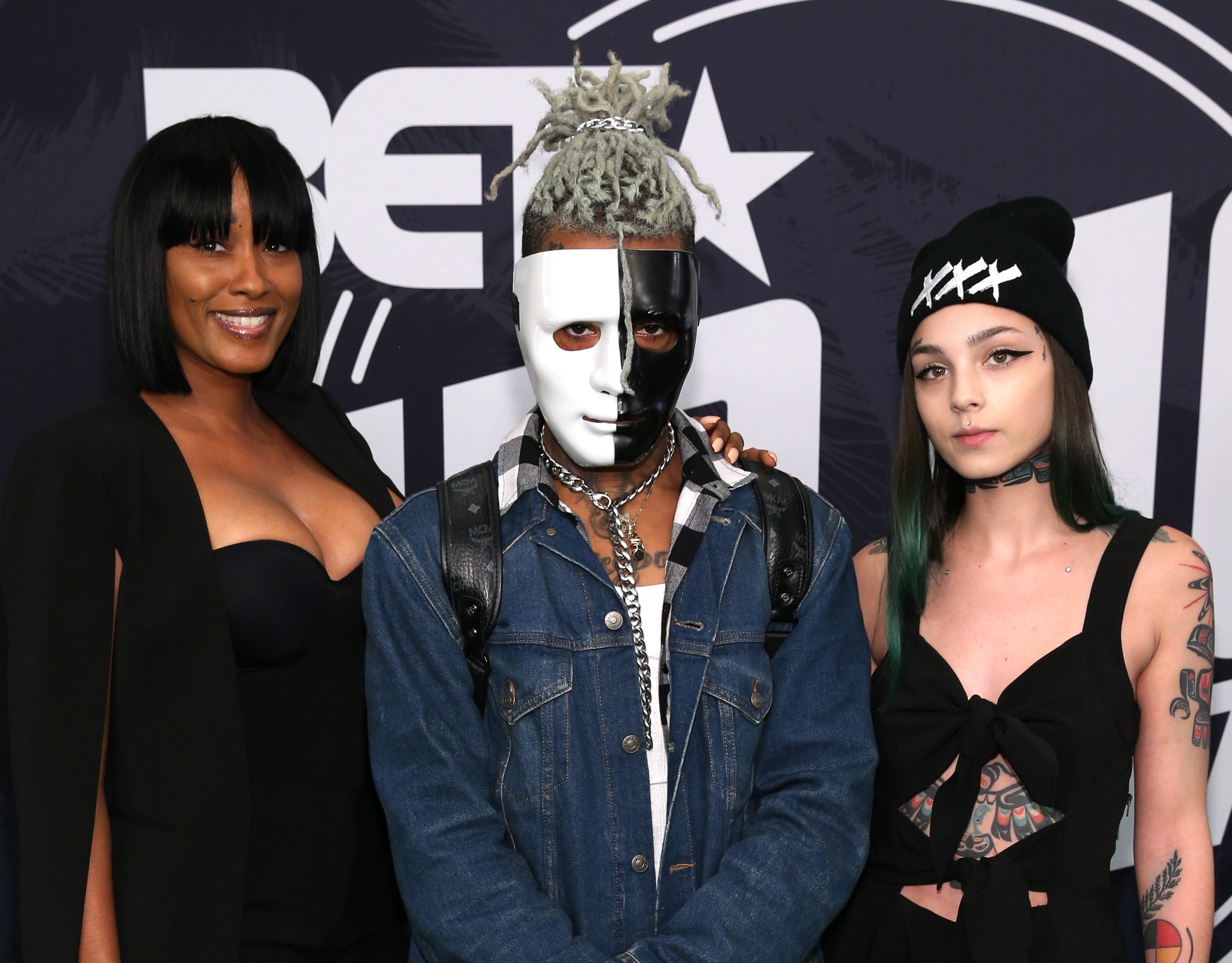 Rapper XXXTentacion (C) attends the BET Hip Hop Awards