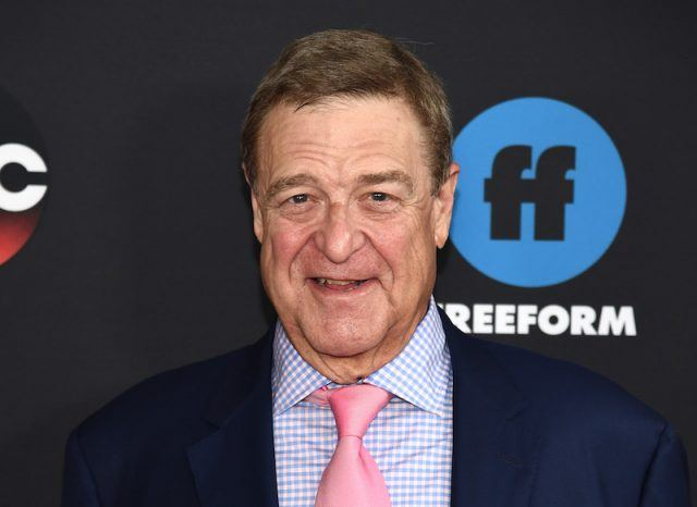 John Goodman on a red carpet.