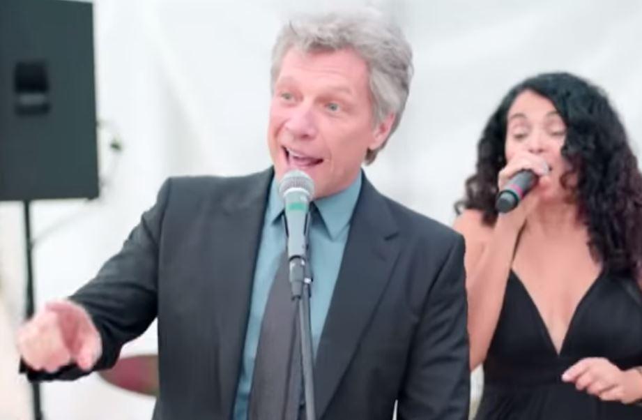Jon Bon Joni performs with the wedding singer.
