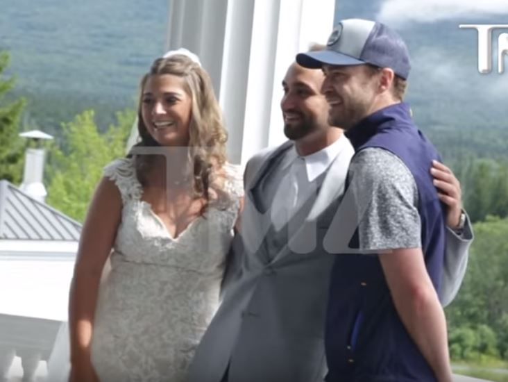 Justin TImberlake poses with the newlyweds.