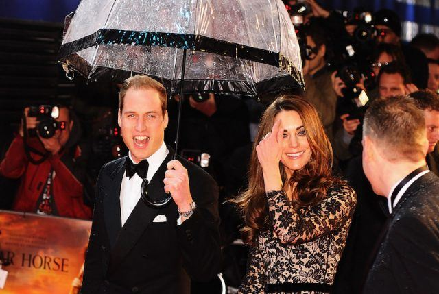 Kate Middleton and Prince William on a red carpet.