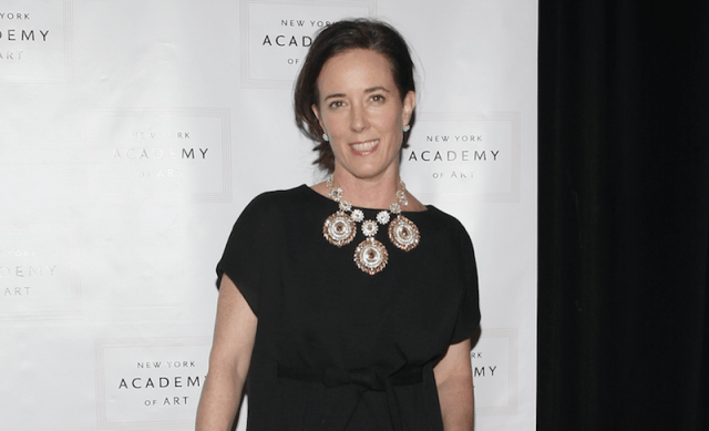 Kate Spade on a red carpet in a black dress.