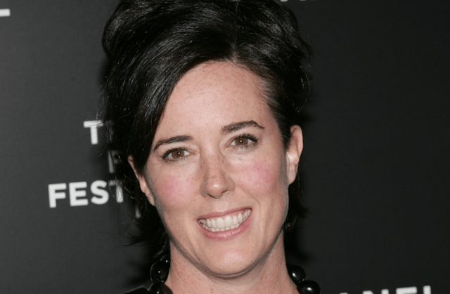Kate Spade smiling on a red carpet.