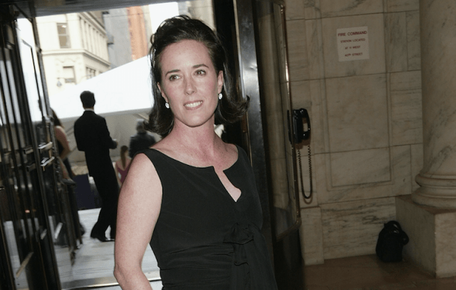 Kate Spade walking into a building.
