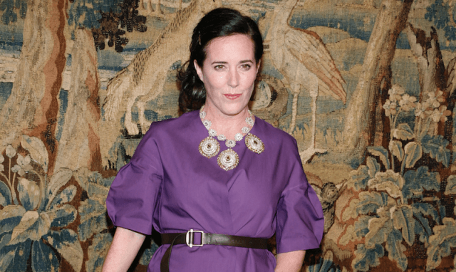 Kate Spade in a purple dress at an event.