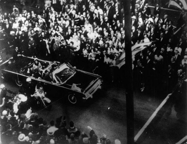 John F Kennedy, 35th president of the US, and his wife Jackie Kennedy travelling in the presidential motorcade at Dallas, before his assassination