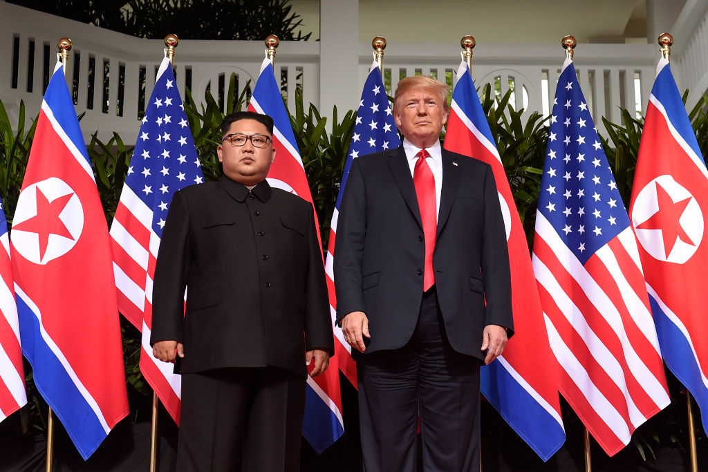 US President Donald Trump (R) poses with North Korea's leader Kim Jong Un