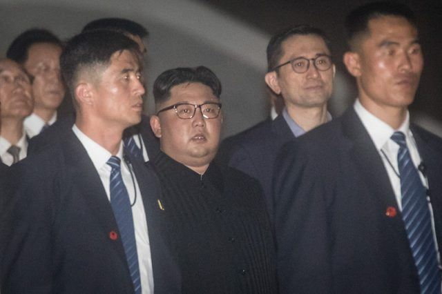 Kim Jong Un walking with his bodyguards in Singapore.