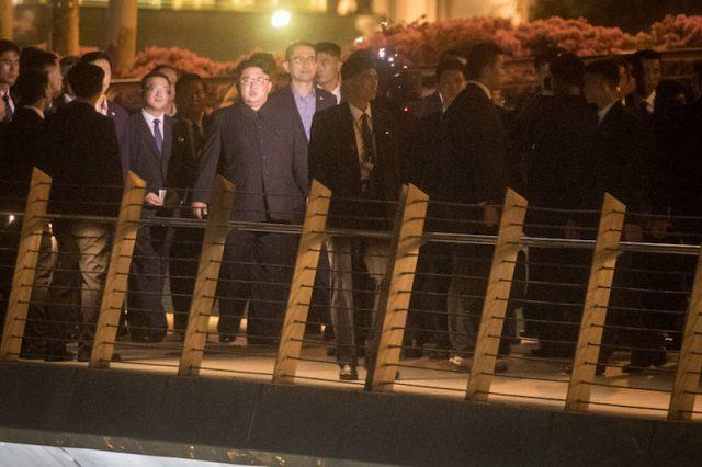 Kim Jong Un walking on the bridge in Singapore.