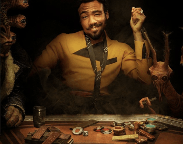 Lando sitting at a table with tokens and cards.