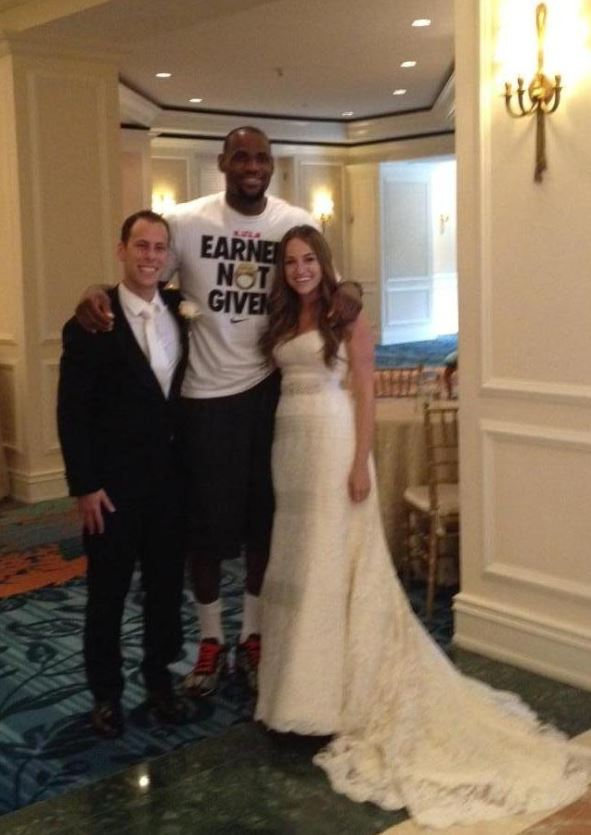 NBA star LeBron James poses with the happy newlyweds.