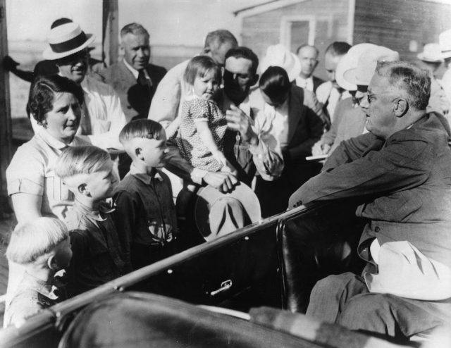 President Franklin Roosevelt talking to people on the street