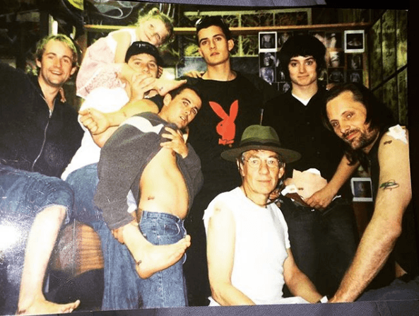 "The cast of ""Lord of the Rings"" showing their matching tattoos"