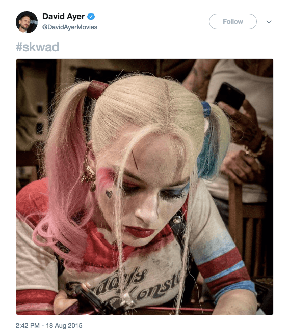 Margot Robbie in her Suicide Squad costume tattooing a co-star