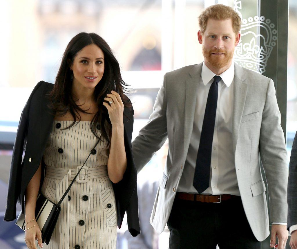 Britain's Prince Harry (R) and his fiancee US actress Meghan Markle, arrive to attend a reception with delegates from the Commonwealth Youth Forum