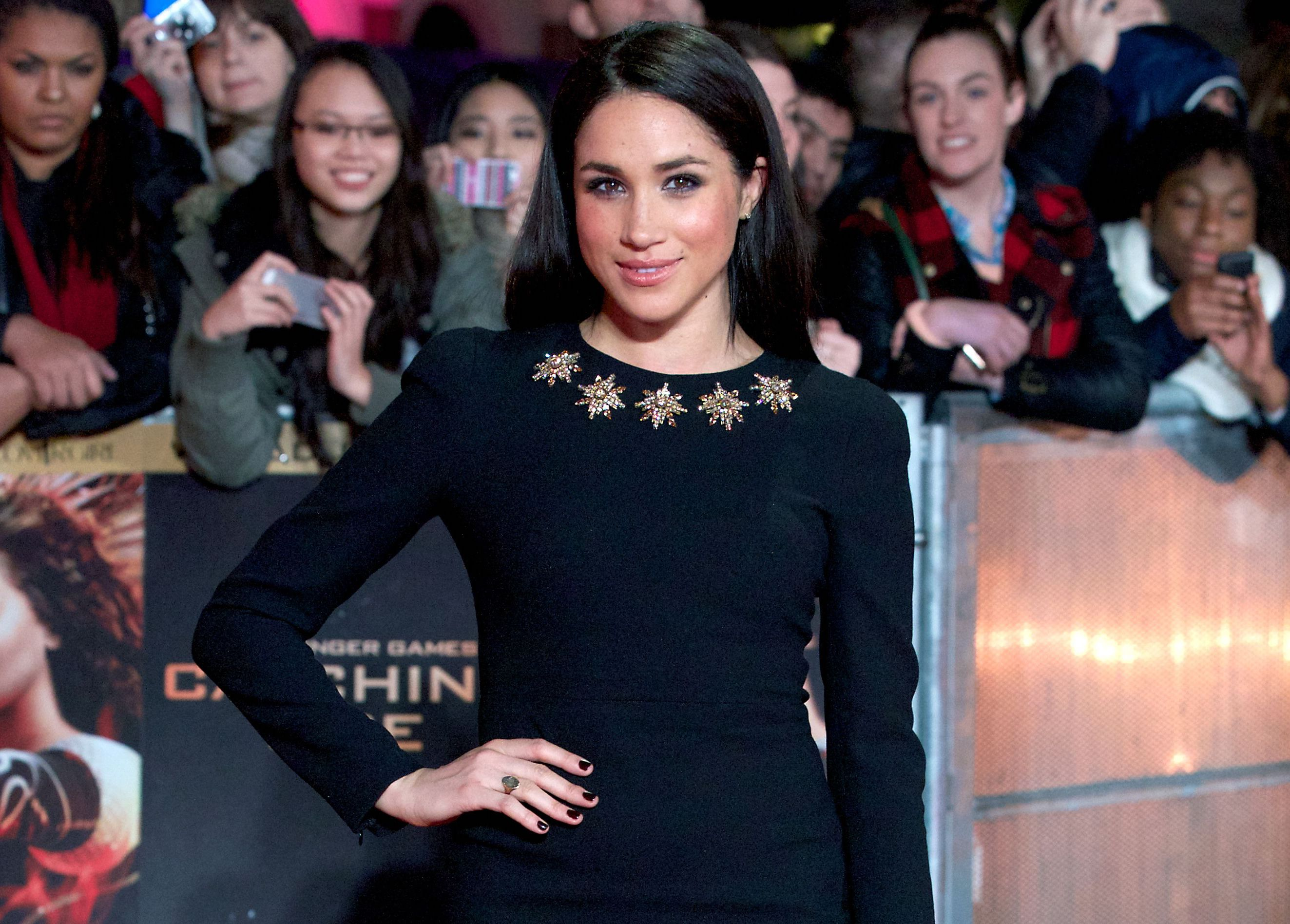"""Meghan Markle at the premier of """"The Hunger Games: Catching Fire"""""""