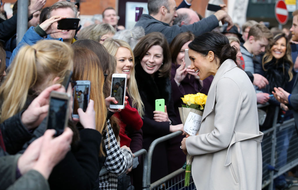 Prince Harry's fiancee, US actress Meghan Markle greets well-wishers during a walkabout in Belfast