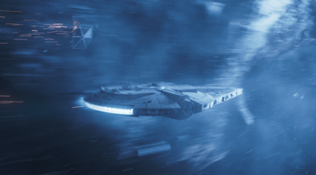 The Millennium Falcon flying at high speed.
