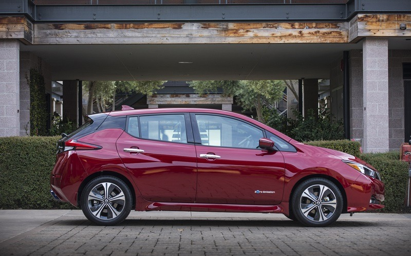 A red 2018 Nissan Leaf in profile