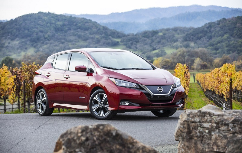 A red 2018 Nissan Leaf from driver's side