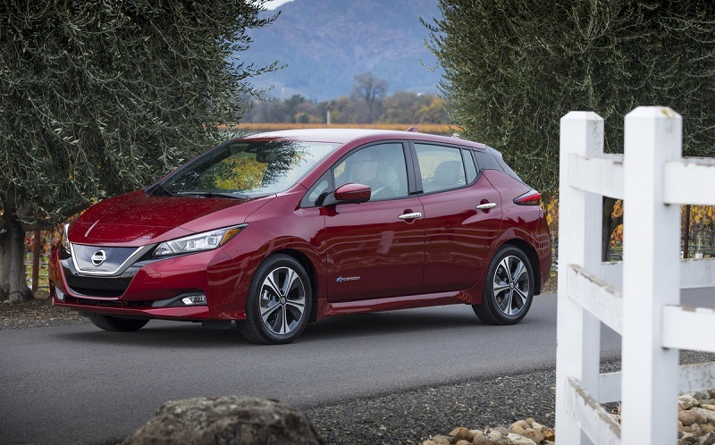 A red 2018 Nissan Leaf front three-quarter view