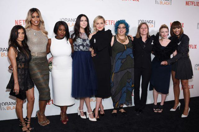 Cast members of 'Orange is the New Black' on a red carpet.