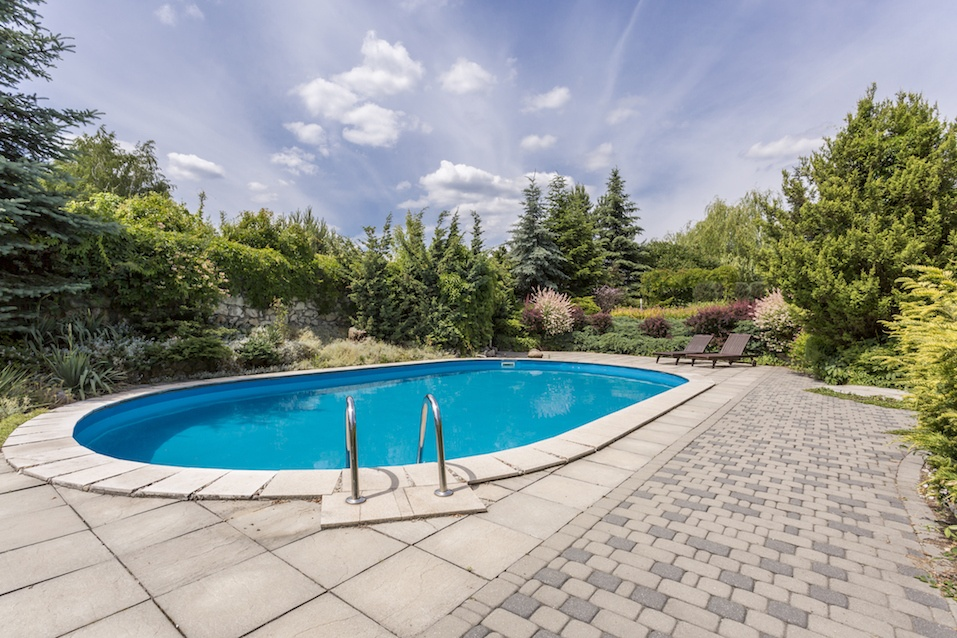 Oval swimming pool in garden