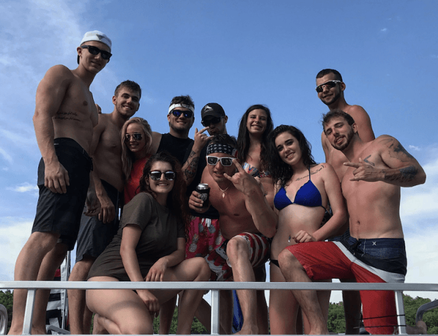 A group of people posing together at party cove.