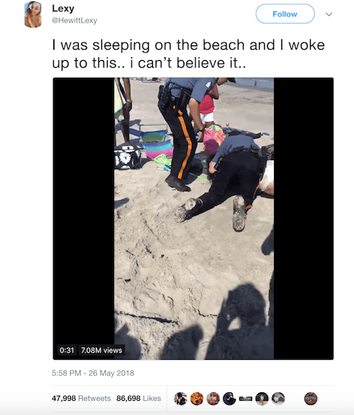 A video of a police officer arresting a woman on the beach.