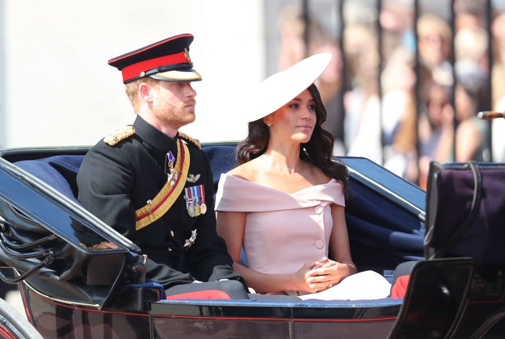 Prince Harry, Duke of Sussex, and Meghan, Duchess of Sussex, during Trooping The Colour